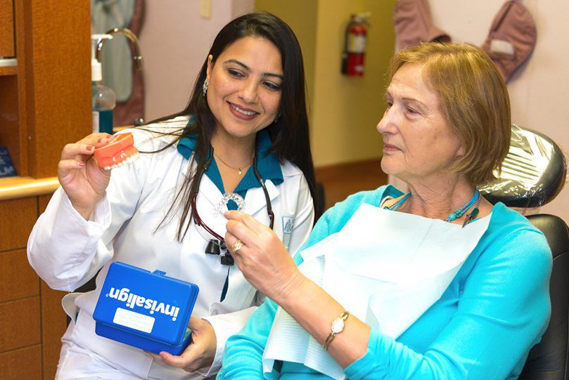 Dr. Saboowala explaining a dental procedure to her patient 07